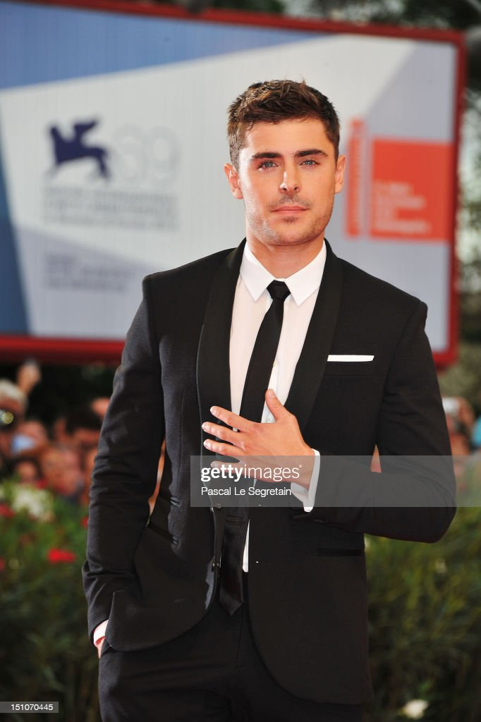 Actor <a gi-track='captionPersonalityLinkClicked' href=/galleries/search?phrase=Zac+Efron&family=editorial&specificpeople=533070 ng-click='$event.stopPropagation()'>Zac Efron</a> attends the 'At Any Price' premiere during the 69th Venice Film Festival at the Palazzo del Cinema on August 31, 2012 in Venice, Italy.