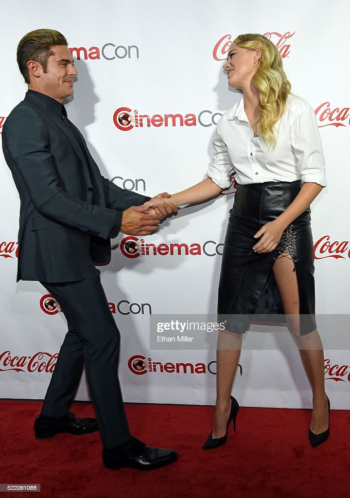 Actor Zac Efron, one of the recipients of the Comedy Stars of the Year Award, and actress Maika Monroe, one of the recipients of the Ensemble of the Universe Award for 'Independence Day: Resurgence,' greet each other at the CinemaCon Big Screen Achievement Awards brought to you by the Coca-Cola Company at Omnia Nightclub at Caesars Palace during CinemaCon, the official convention of the National Association of Theatre Owners, on April 14, 2016 in Las Vegas, Nevada.