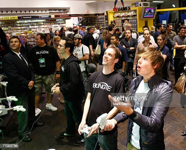 Actor Zac Efron plays against Bungie head of production Jonty Barnes at the 'Halo 3' Midnight Madness Event held at the Game Spot on September 242007...