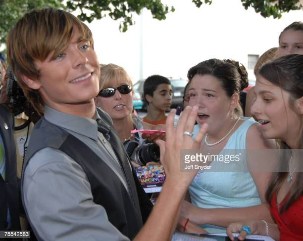 Actor Zac Efron signs autographs for fans before the premiere of 'Hairspray' July 18 2007 at the Charles Theatre in Baltimore Maryland