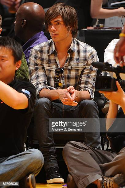 Actor Zac Efron watches a game from courtside between the Houston Rockets and the Los Angeles Lakers at Staples Center on April 3 2009 in Los Angeles...