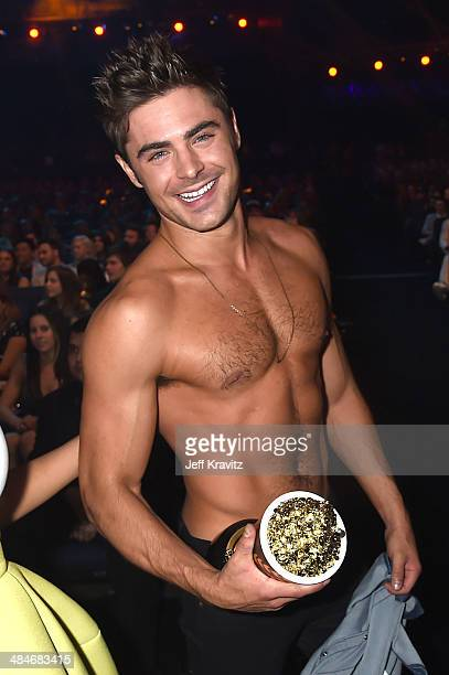 Actor Zac Efron winner of the Best Shirtless Performance award for 'That Awkward Moment' attends the 2014 MTV Movie Awards at Nokia Theatre LA Live...