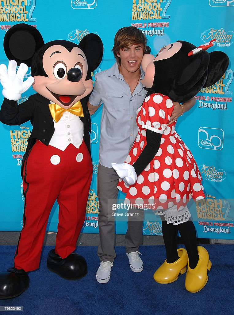 Actor <a gi-track='captionPersonalityLinkClicked' href=/galleries/search?phrase=Zac+Efron&family=editorial&specificpeople=533070 ng-click='$event.stopPropagation()'>Zac Efron</a> (center) with Mickey Mouse and Minnie Mouse arrive at the premiere of 'High School Musical 2' at the Downtown Disney District at Disneyland Resort on August 14, 2007 in Anaheim, California.