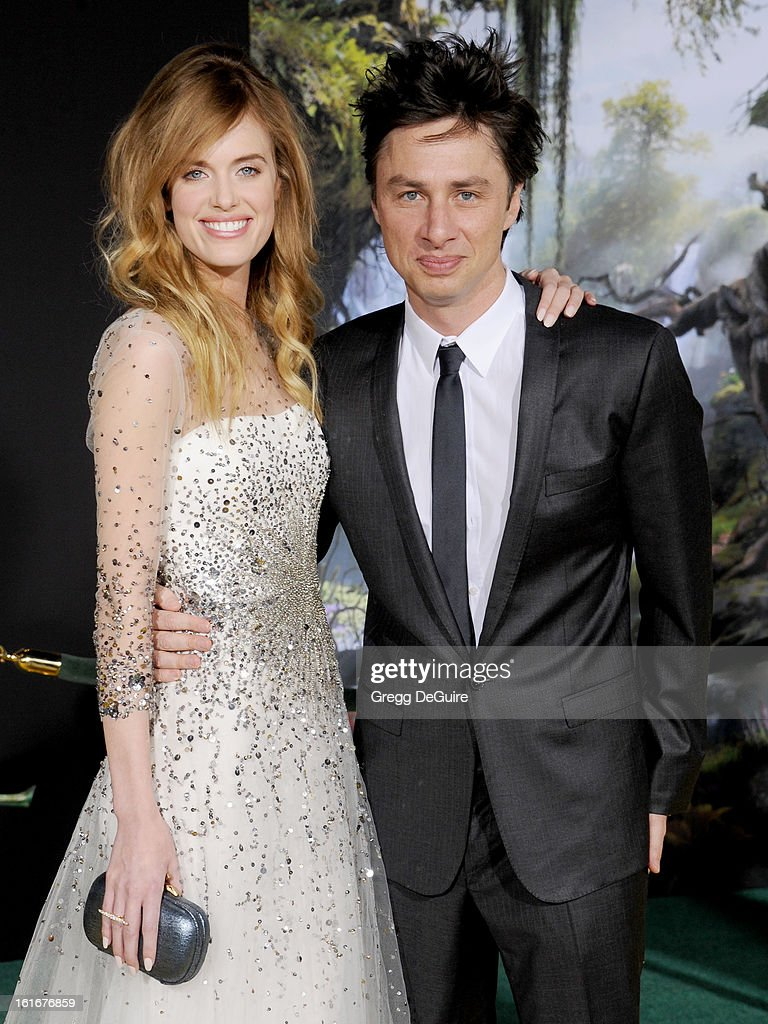 Actor Zach Braff (R) and model Taylor Bagley arrive at the Los Angeles premiere of 'Oz The Great and Powerful' at the El Capitan Theatre on February 13, 2013 in Hollywood, California.