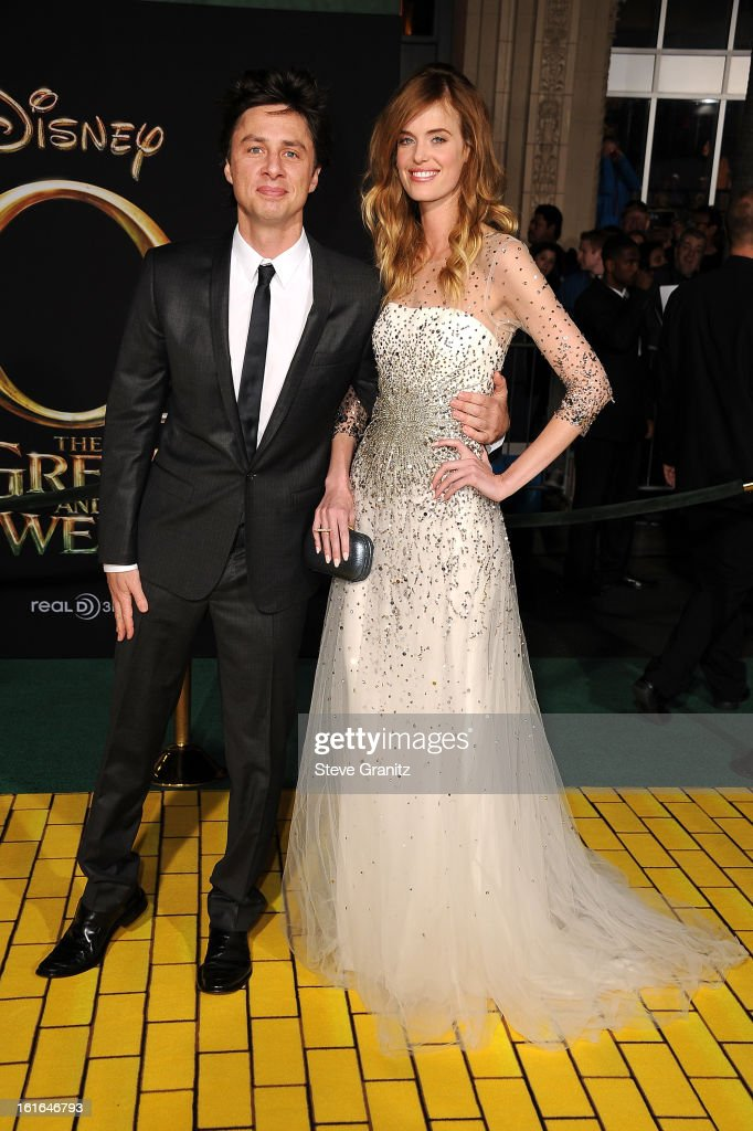 Actor Zach Braff (L) and model Taylor Bagley attend the world premiere of Disney's 'OZ The Great And Powerful' at the El Capitan Theatre on February 13, 2013 in Hollywood, California.