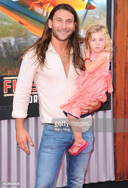 Actor Zach McGowan and guest attend the premiere of 'Planes Fire Rescue' on July 15 2014 at the El Capitan Theatre in Hollywood California