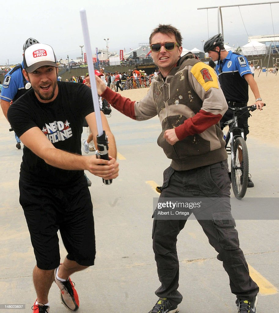 Actor Zachary Levi and actor/host Chris Hardwick participate in The Inaugural 'Course Of The Force' Olympic Relay Run with lightsabers to Benefit The Make-A-Wish Foundation hosted by LucasFilm, Nerdist Industries and Octagon held at The Santa Monica Pier on July 7, 2012 in Santa Monica, California.