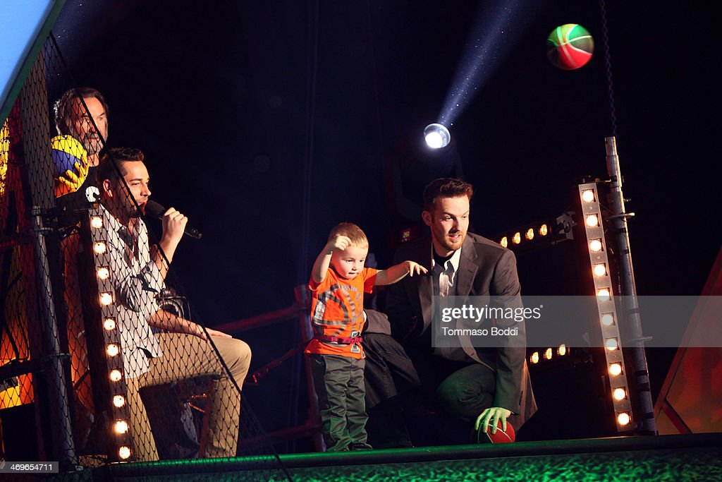 Actor Zachary Levi, basketball prodigy Titus Ashby and Joseph Ashby onstage during the 4th Annual Cartoon Network Hall Of Game Awards held at the Barker Hangar on February 15, 2014 in Santa Monica, California.