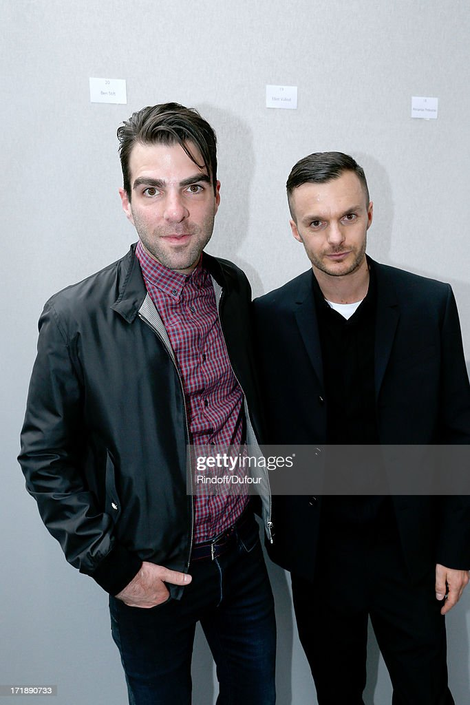Actor <a gi-track='captionPersonalityLinkClicked' href=/galleries/search?phrase=Zachary+Quinto&family=editorial&specificpeople=715956 ng-click='$event.stopPropagation()'>Zachary Quinto</a> and Fashion designer Kris Van Assche backstage after Dior Homme Menswear Spring/Summer 2014 Show as part of the Paris Fashion Week on June 29, 2013 in Paris, France.