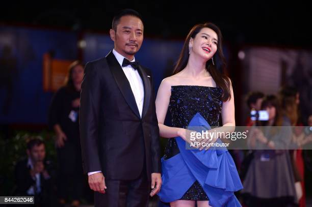 Actor Zhang Hanyu and actress Qi Wei attend the premiere of the movie 'Zhuibu' presented out of competition at the 74th Venice Film Festival on...