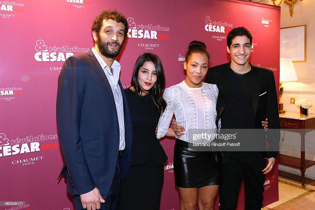 Actor Zinedine Benchenine (1st R) sponsored by humorist Ramzy Bedia (1st L) for the movie 'Vandal' with actress Chloe Lecerf (2nd R) sponsored by actress Leila Bekhti (2nd L) at the Chaumet's Cocktail Party for Cesar's Revelations 2014 at Musee Chaumet, followed by a dinner at Hotel Meurice on January 13, 2014 in Paris, France.