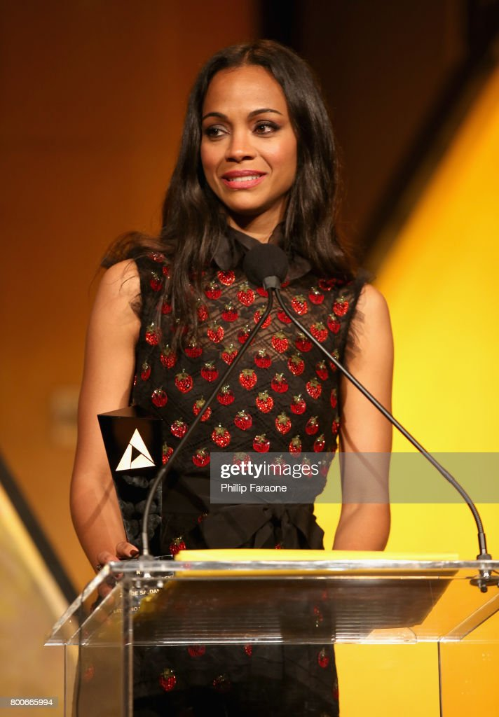 Actor Zoe Saldana accepts an award from Vin Diesel on stage at the NALIP Latino Media Awards at The Ray Dolby Ballroom at Hollywood & Highland Center on June 24, 2017 in Hollywood, California.