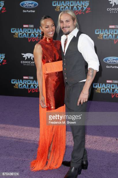 Actor Zoe Saldana and artist Marco Perego at the premiere of Disney and Marvel's 'Guardians Of The Galaxy Vol 2' at Dolby Theatre on April 19 2017 in...