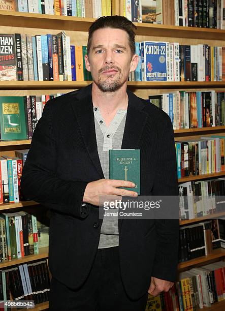 Actor/author Ethan Hawke poses with a copy of his book 'Rules For A Knight' at a signing for 'Rules For A Knight' at Book Court on November 10 2015...