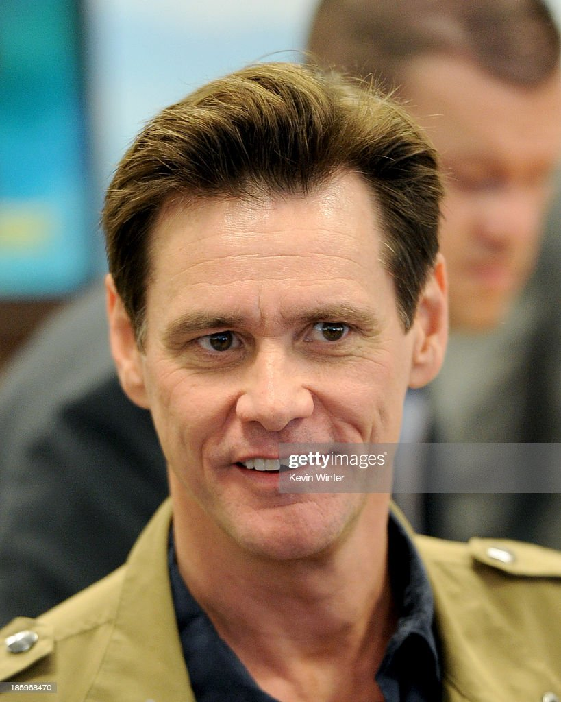 Actor/author <a gi-track='captionPersonalityLinkClicked' href=/galleries/search?phrase=Jim+Carrey&family=editorial&specificpeople=171515 ng-click='$event.stopPropagation()'>Jim Carrey</a> appears at a reading and book signing for 'How Roland Rolls' at Barnes and Noble on October 26, 2013 in Los Angeles, California
