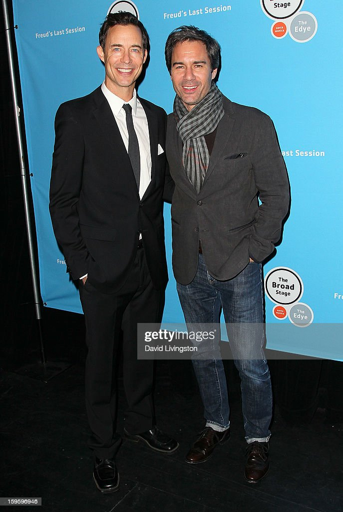 Actor/cast member Tom Cavanagh (L) and actor <a gi-track='captionPersonalityLinkClicked' href=/galleries/search?phrase=Eric+McCormack&family=editorial&specificpeople=202857 ng-click='$event.stopPropagation()'>Eric McCormack</a> pose at the opening night of 'Freud's Last Session' at The Broad Stage at the Santa Monica College Performing Arts Center on January 16, 2013 in Santa Monica, California.