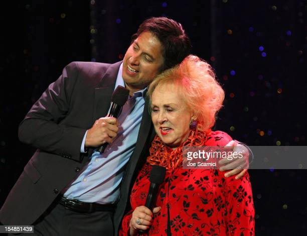 Actor/comedian and event host Ray Romano and actress and IMF Honorary Committee member Doris Roberts perform onstage at the International Myeloma...