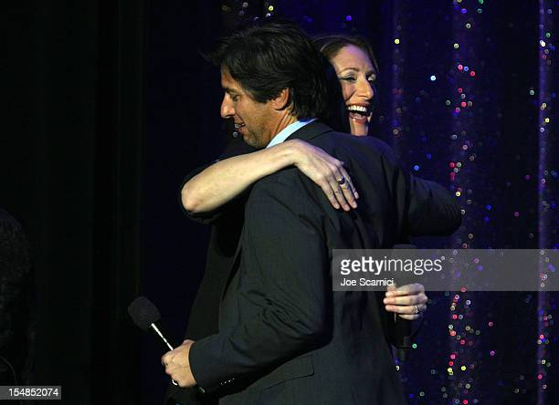 Actor/comedian and event host Ray Romano introduces performer Judy Gold onstage to the audience at the International Myeloma Foundation's 6th Annual...