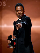 Actorcomedian Chris Rock accepts the Hollywood Comedy Film Award for 'Top Five' onstage during the 18th Annual Hollywood Film Awards at The Palladium...