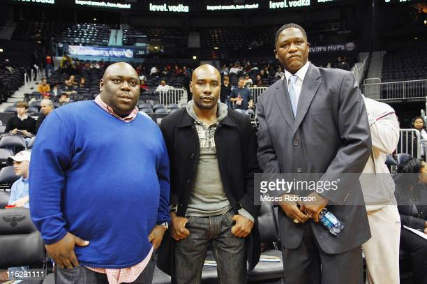 Actorcomedian Faizon Love actor Morris Chestnut and former NBA player and Hall of Famer Dominique Wilkins attending the Atlanta Hawks vs Minnesota...