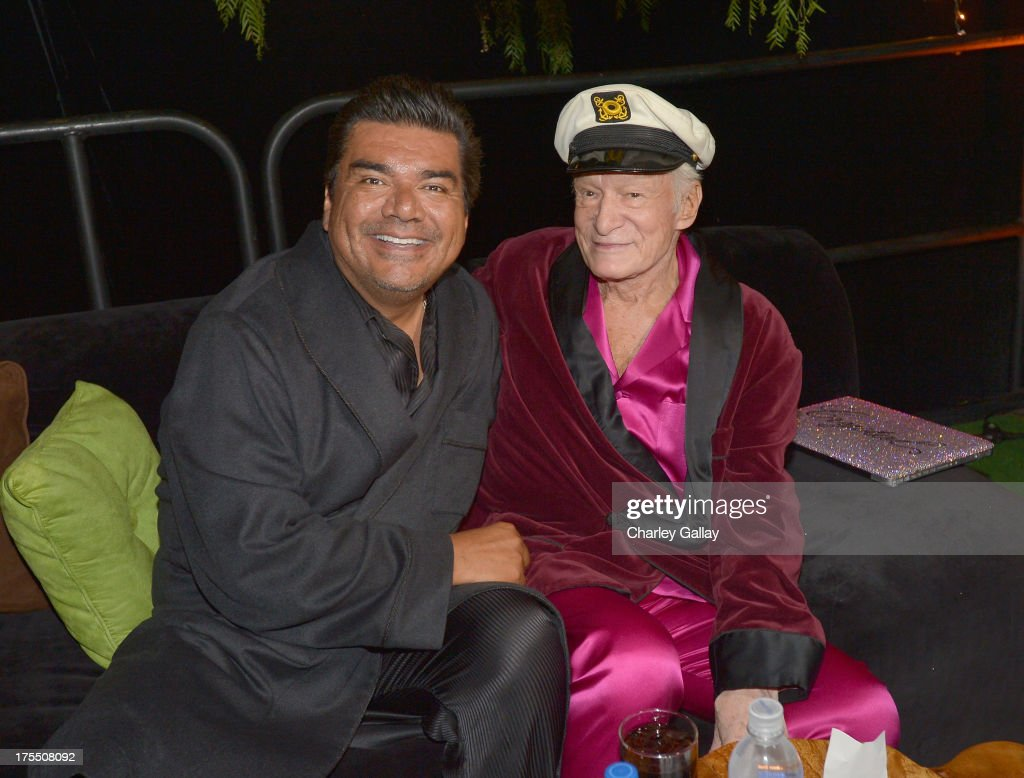 Actor/comedian George Lopez and Hugh Hefner attend Hugh Hefner's annual Midsummer Night's Dream party held at the Playboy Mansion on August 3 2013 in...