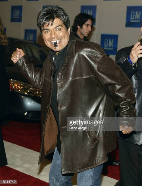 Actor/Comedian George Lopez gestures as he arrives for the 3rd Annual 'ten' fashion show and charity event to celebrate awards season and car culture...