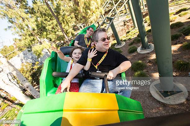 Actor/comedian Patton Oswalt and his daughter Alice Oswalt ride The Dragon roller coaster at LEGOLAND on February 6 2016 in Carlsbad California