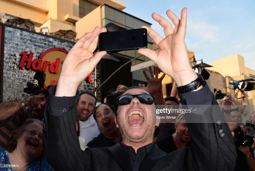 Actor/Comedian <a gi-track='captionPersonalityLinkClicked' href=/galleries/search?phrase=Ricky+Gervais&family=editorial&specificpeople=209237 ng-click='$event.stopPropagation()'>Ricky Gervais</a> arrives for the premiere of Disney's 'Muppets Most Wanted' at the El Capitan Theatre on March 11, 2014 in Hollywood, California.