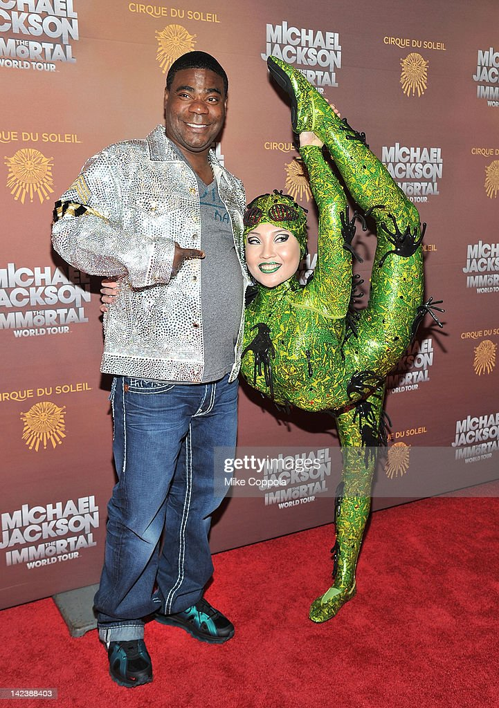 Actor/comedian <a gi-track='captionPersonalityLinkClicked' href=/galleries/search?phrase=Tracy+Morgan&family=editorial&specificpeople=182428 ng-click='$event.stopPropagation()'>Tracy Morgan</a> (L) poses for a picture with a Cirque du Soleil cast member for Michael Jackson the Immortal World Tour of at Madison Square Garden on April 3, 2012 in New York City.