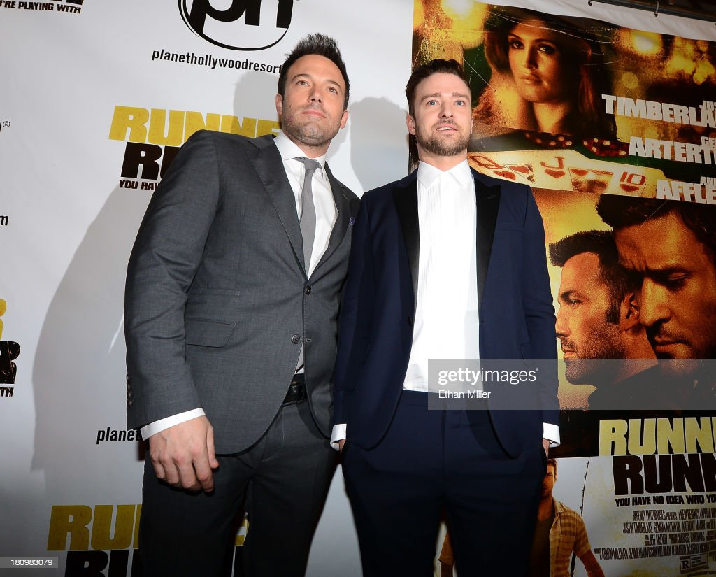 Actor/director Ben Affleck (L) and singer/actor Justin Timberlake arrive at the world premiere of Twentieth Century Fox and New Regency's film 'Runner Runner' at Planet Hollywood Resort & Casino on September 18, 2013 in Las Vegas, Nevada.