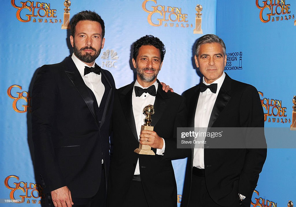 Actor-director Ben Affleck, producer Grant Heslov, and actor-producer George Clooney pose in the press room at the 70th Annual Golden Globe Awards held at The Beverly Hilton Hotel on January 13, 2013 in Beverly Hills, California.
