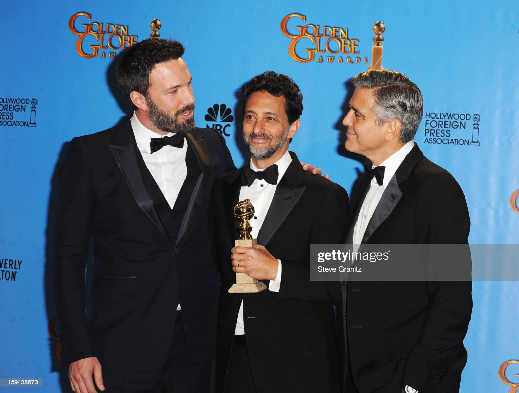 Actor-director <a gi-track='captionPersonalityLinkClicked' href=/galleries/search?phrase=Ben+Affleck&family=editorial&specificpeople=201856 ng-click='$event.stopPropagation()'>Ben Affleck</a>, producer <a gi-track='captionPersonalityLinkClicked' href=/galleries/search?phrase=Grant+Heslov&family=editorial&specificpeople=607201 ng-click='$event.stopPropagation()'>Grant Heslov</a>, and actor-producer <a gi-track='captionPersonalityLinkClicked' href=/galleries/search?phrase=George+Clooney&family=editorial&specificpeople=202529 ng-click='$event.stopPropagation()'>George Clooney</a> pose in the press room at the 70th Annual Golden Globe Awards held at The Beverly Hilton Hotel on January 13, 2013 in Beverly Hills, California.