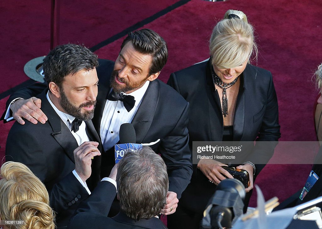 Actor/director Ben Affleck with actor Hugh Jackman and Actor Hugh Jackman (L) and actress Deborah Lee Furness arrive at the Oscars held at Hollywood & Highland Center on February 24, 2013 in Hollywood, California.