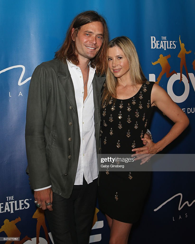 Actor/director Christopher Backus (L) and his wife, actress Mira Sorvino, attend the 10th anniversary celebration of 'The Beatles LOVE by Cirque du Soleil' at The Mirage Hotel & Casino on July 14, 2016 in Las Vegas, Nevada.