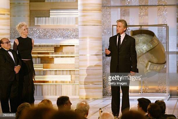 Actor/Director Danny De Vito and Actress Sharon Stone present an award to Actor Michael Douglas on stage at the 61st Annual Golden Globe Awards on...