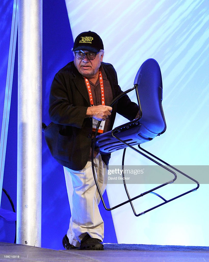 Actor/director Danny DeVito carries his own chair as he arrives to speak at the Panasonic booth during the 2013 International CES at the Las Vegas Convention Center on January 9, 2013 in Las Vegas, Nevada. CES, the world's largest annual consumer technology trade show, runs through January 11 and is expected to feature 3,100 exhibitors showing off their latest products and services to about 150,000 attendees.