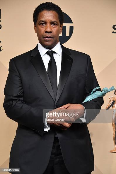 Actor/director Denzel Washington winner of the Outstanding Male Actor in a Leading Role award for 'Fences' poses in the press room during the 23rd...