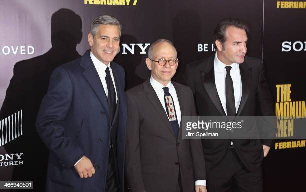 Actor/director George Clooney actors Bob Balaban and Jean Dujardin attend the 'Monument Men' premiere at Ziegfeld Theater on February 4 2014 in New...