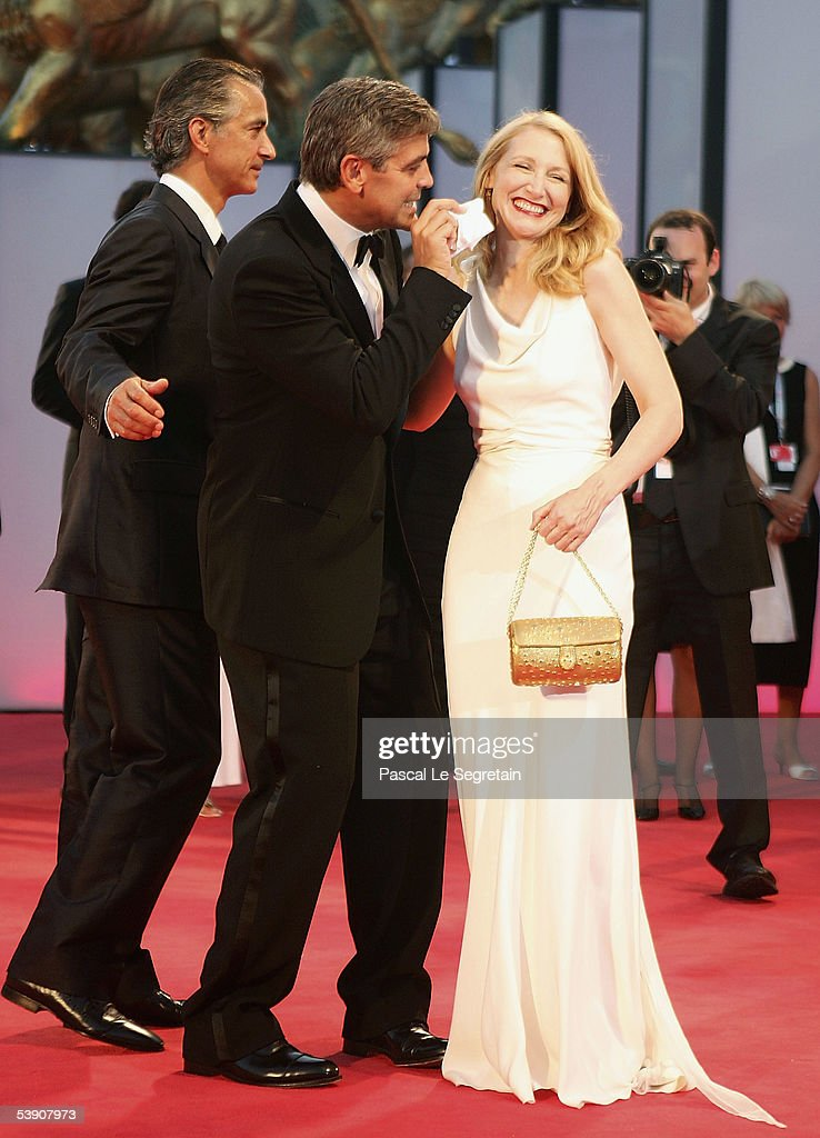 Actor/Director George Clooney plays the fool with his co-star Patricia Clarkson at the premiere for his film 'Good Night, And Good Luck' at the Palazzo del Cinema on the second day of the 62nd Venice Film Festival on September 1, 2005 in Venice, Italy.