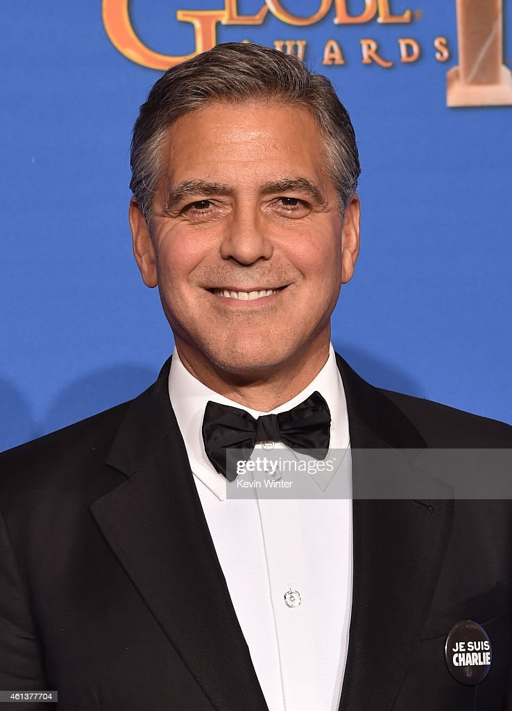 Actor/director <a gi-track='captionPersonalityLinkClicked' href=/galleries/search?phrase=George+Clooney&family=editorial&specificpeople=202529 ng-click='$event.stopPropagation()'>George Clooney</a>, recipient of the Cecil B. DeMille Award, poses in the press room during the 72nd Annual Golden Globe Awards at The Beverly Hilton Hotel on January 11, 2015 in Beverly Hills, California.