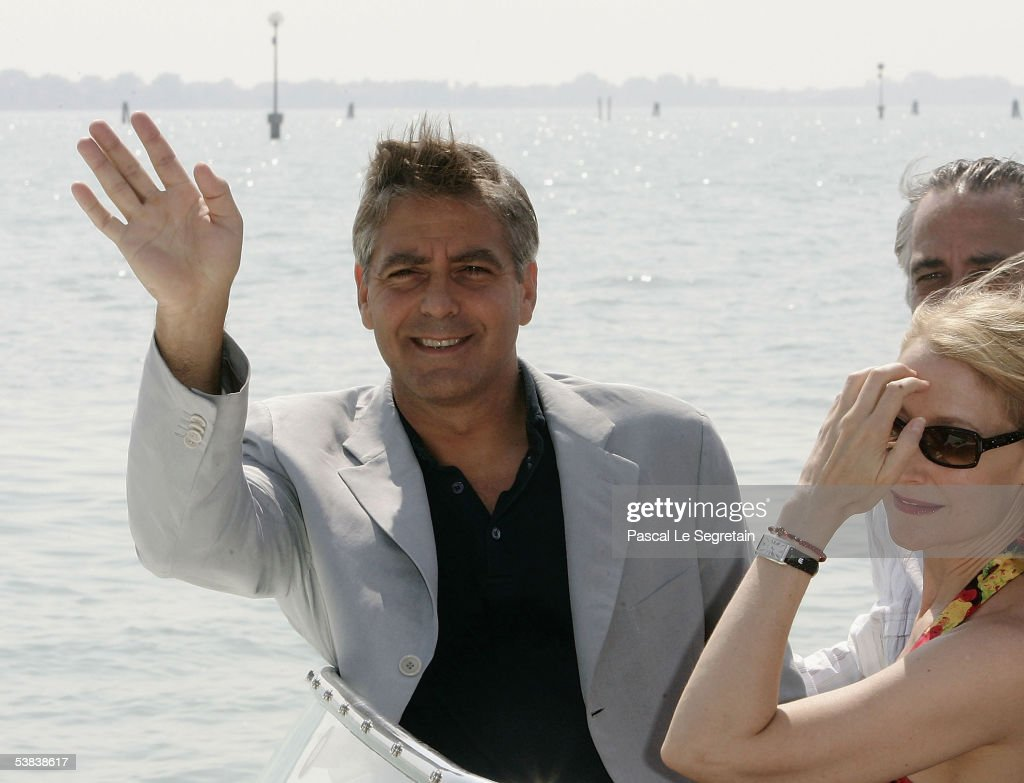 Actor/director George Clooney waves from the water-taxi as he arrives with co-stars David Strathairn and Patricia Clarkson for the press conference for 'Good Night, And Good Luck' on the second day of the 62nd Venice Film Festival on September 1, 2005 in Venice, Italy.