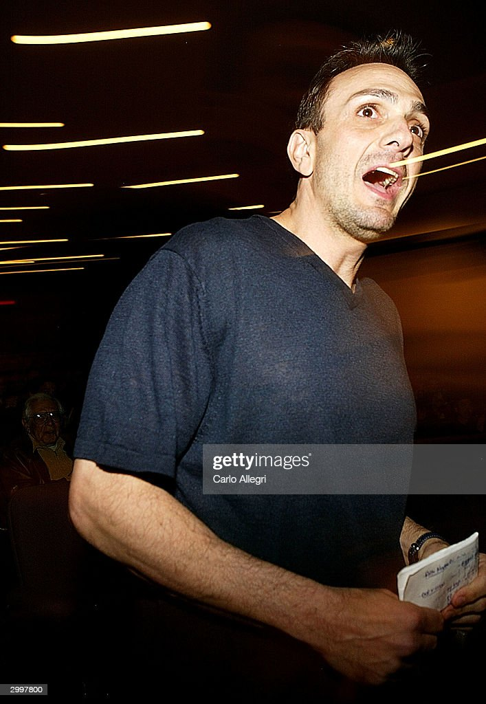 Actor/Director Hank Azaria runs down the aisle to introduce his short film 'Nobody's Perfect' at the Writers Guild February 19, 2004 in Los Angeles, California.