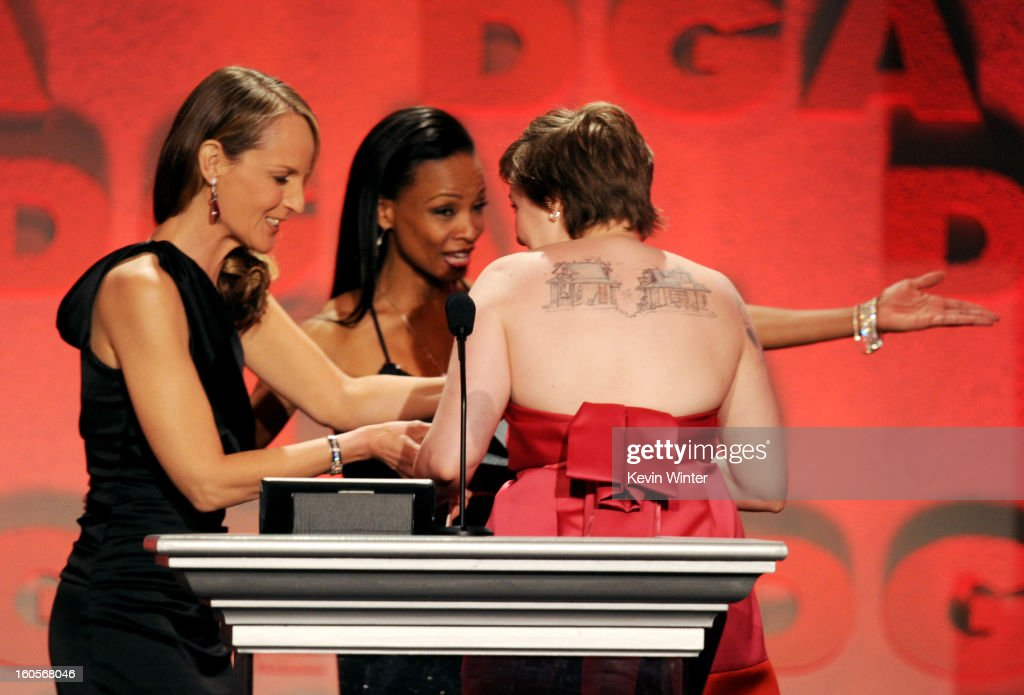 Actor/director Lena Dunham (R) accepts the Outstanding Directorial Achievement in Comedy Series for 2012 award for 'Girls' pilot episode from actress Helen Hunt (L) onstage during the 65th Annual Directors Guild Of America Awards at Ray Dolby Ballroom at Hollywood & Highland on February 2, 2013 in Los Angeles, California.
