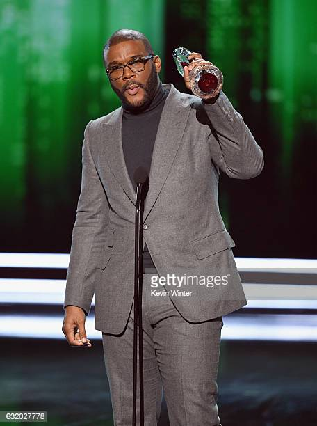 Actor/director Tyler Perry accepts the Favorite Humanitarian award onstage during the People's Choice Awards 2017 at Microsoft Theater on January 18...