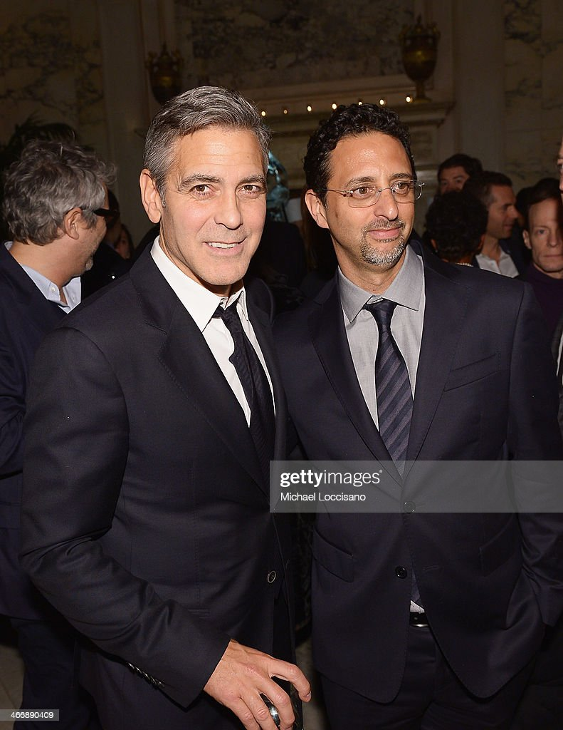 Actor/director/producer Gearge Clooney (L) and producer <a gi-track='captionPersonalityLinkClicked' href=/galleries/search?phrase=Grant+Heslov&family=editorial&specificpeople=607201 ng-click='$event.stopPropagation()'>Grant Heslov</a> attend the after party following the 'Monuments Men' premiere at The Metropolitain Club on February 4, 2014 in New York City.