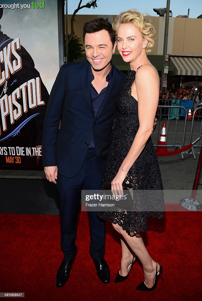 Actor/Director/Writer Seth MacFarlane and actress Charlize Theron attend the premiere of Universal Pictures and MRC's 'A Million Ways To Die In The West' at Regency Village Theatre on May 15, 2014 in Westwood, California.