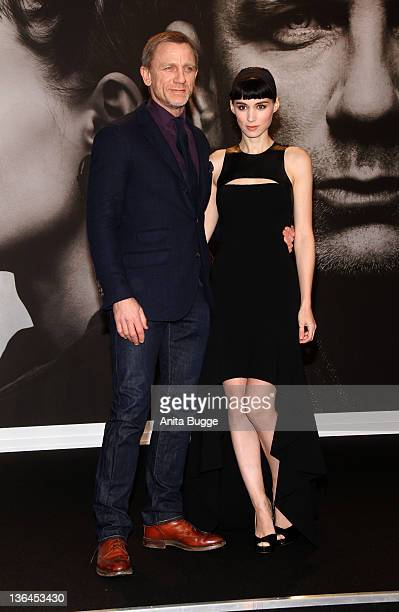 Actore Daniel Craig and actress Rooney Mara attend the 'The Girl With The Dragon Tattoo' Germany Premiere at the Cinestar movie theater on January 5...