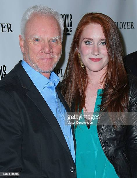 Actor/Executive Producer Malcolm McDowell and actress Paige Howard arrive for the screening Of 'The Employer' at Regent Showcase Theatre on March 6...