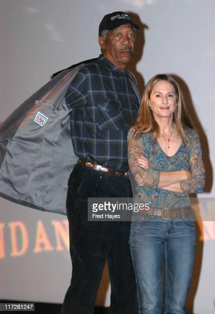 Actor/executive producer Morgan Freeman gives Holly Hunter his coat