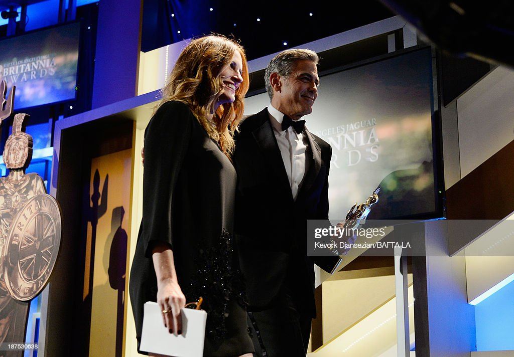 Actor/filmmaker <a gi-track='captionPersonalityLinkClicked' href=/galleries/search?phrase=George+Clooney&family=editorial&specificpeople=202529 ng-click='$event.stopPropagation()'>George Clooney</a> (R), recipient of the Stanley Kubrick Britannia Award for Excellence in Film, and actress <a gi-track='captionPersonalityLinkClicked' href=/galleries/search?phrase=Julia+Roberts&family=editorial&specificpeople=202605 ng-click='$event.stopPropagation()'>Julia Roberts</a> walk offstage during the 2013 BAFTA LA Jaguar Britannia Awards presented by BBC America at The Beverly Hilton Hotel on November 9, 2013 in Beverly Hills, California.